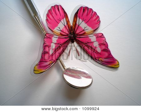 Dental Mirrow And Butterfly
