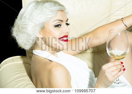 Woman In Chair With Wine
