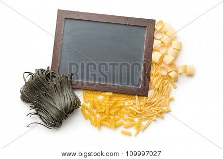 various pasta and chalkboard on white background