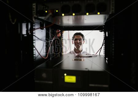 Technician working on the server at the data centre