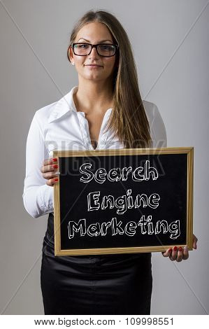 Search Engine Marketing Sem - Young Businesswoman Holding Chalkboard With Text