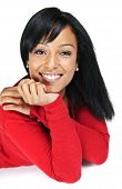stock photo of mixed race  - Portrait of black woman smiling laying isolated on white background - JPG