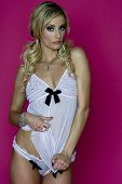stock photo of racy  - young woman wearing some racy white lingery - JPG