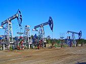 stock photo of nonrenewable  - Oil pumps in Surgut, West Siberia, Russia. Oil industry equipment. ** Note: Slight graininess, best at smaller sizes - JPG