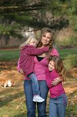 picture of mother child  - mother and daughters smiling and happy in forest - JPG