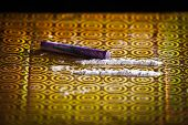 picture of rock cocaine  - Two lines of cocaine on a yellow piece of gift wrapping
