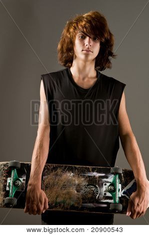 handsome teen boy with skateboard