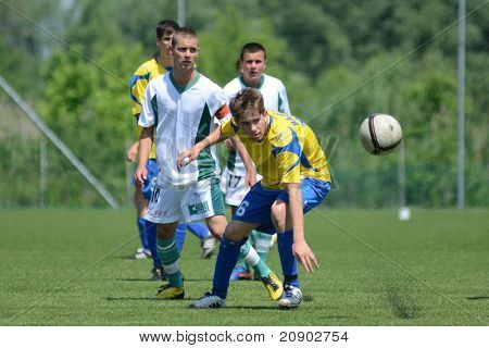 KAPOSVAR, HUNGARY - JUNE 11: Unidentified player in action at the Hungarian National Championship under 13 game between Kaposvari Rakoczi FC and Bajai LSE June 11, 2011 in Kaposvar, Hungary.