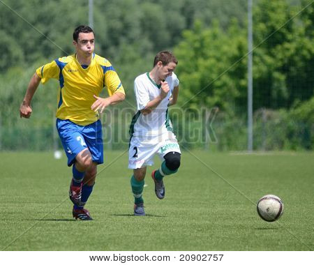 KAPOSVAR, HUNGARY - JUNE 11: Erik Judak (in yellow 2) in action at the Hungarian National Championship under 13 game between Kaposvari Rakoczi FC and Bajai LSE June 11, 2011 in Kaposvar, Hungary.