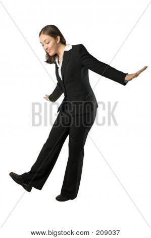 Business Woman Balancing Over White