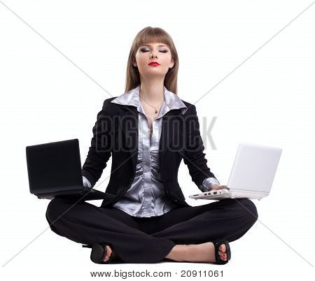 Yong business woman in yoga with two laptop