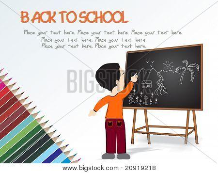 cute boy standing in front of blackboard, drawing scenery