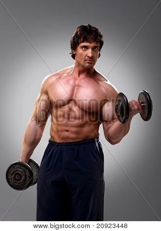 Bodybuilder Doing His Biceps