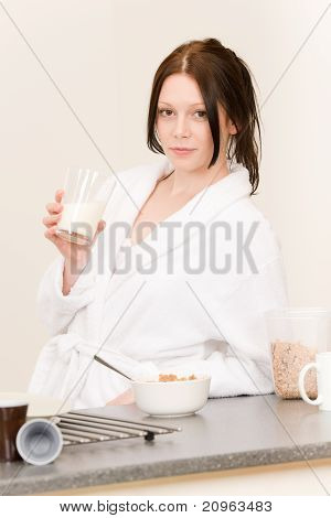 Young Student Girl Have Breakfast In Kitchen