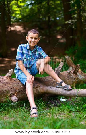 Child Outdoor Sitting On A Log