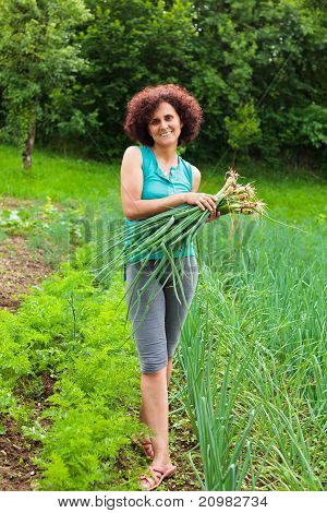 Young Woman With A Sheaf Of Young Onions