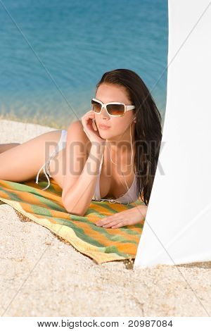 Young Sexy Bikini Model Relaxing With Sunglasses