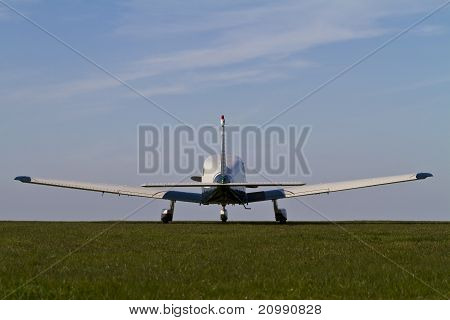 Light Aircraft On A Grass Airfield