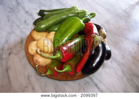 Mixed Fresh Raw Vegetables On A Wooden Platter