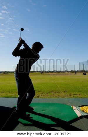 Man At Golf Driving Range