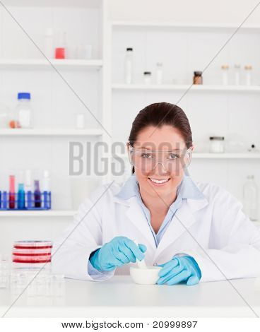 Smiling scientist preparing an experimentation