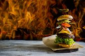 Hamburger with realistic flying ingredients. Tasty smoked grilled and glazed beef burger with lettuc poster