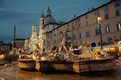 Fountain of Neptune in Piazza Navona in Rome, Italy. poster