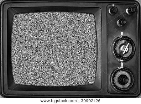 Vintage TV with noise on screen. In B/W