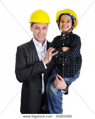 Father and son playing as architects