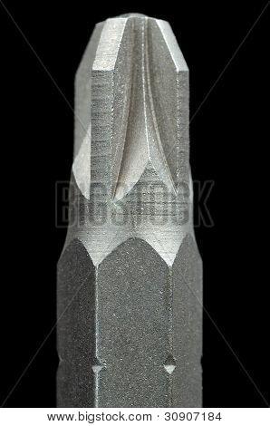 Primer plano de pedacito de destornillador sobre fondo negro
