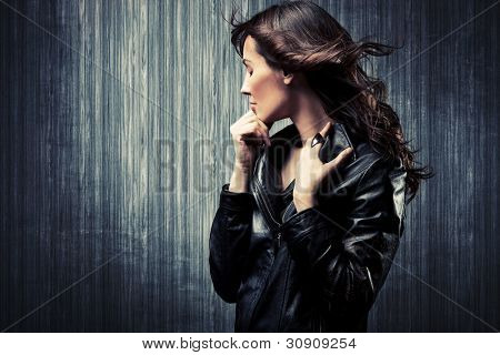 melancholy adult woman in black leather  jacket profile portrait