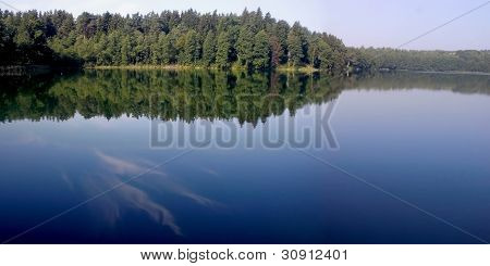 wide deep lake with forest