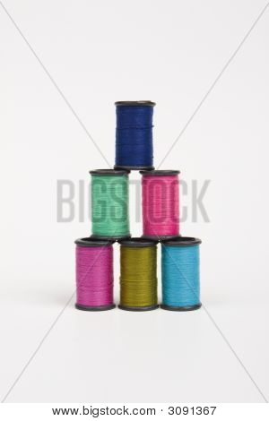 Colorful Spools Of Thread In A Pyramid Shape