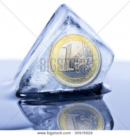 Euro coin frozen into the ice cube