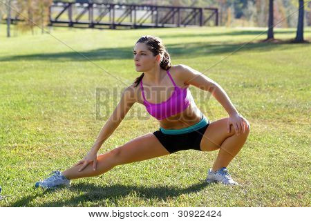 Beautiful Brunette Ahtlete Stretches Outdoors (6)