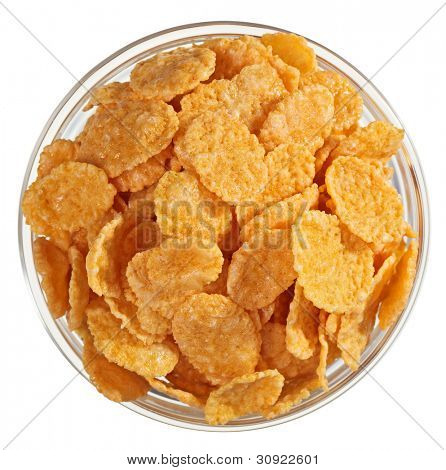 Corn flakes heap in a glass bowl, isolated on white