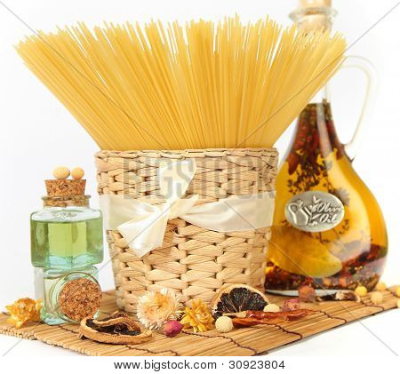 spaghetti and olive oil on white background