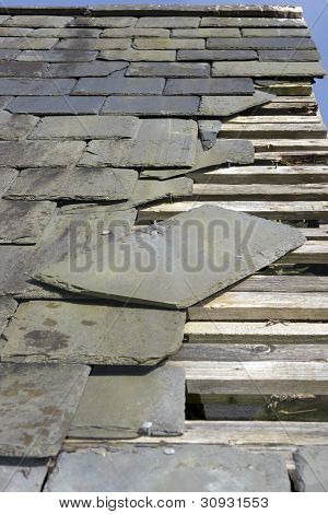 Storm Damaged Roof With Missing Slates