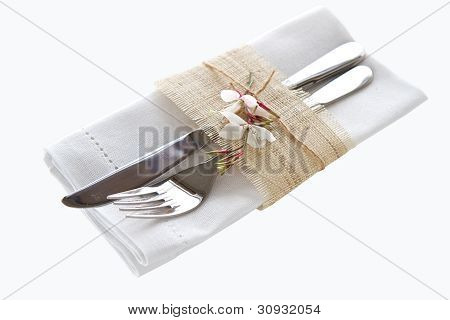 Knife And Fork With Napkin Isolated On White Background