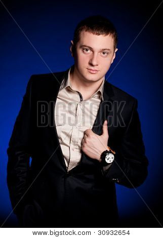 Beautiful man with watch on a blue background