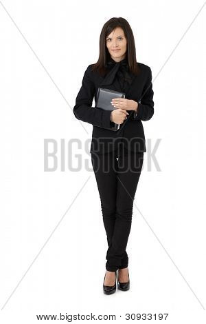 Young businesswoman portrait, holding personal organizer, full length picture isolated on white.