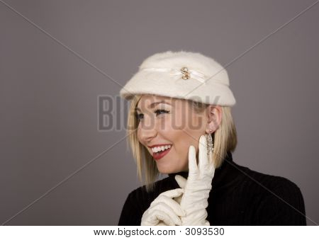 Blonde In Fur Hat Laughing And Looking Off