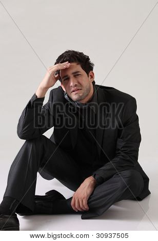 depress businessman sitting on the floor