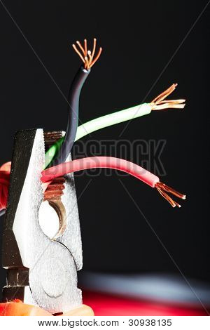 Pliers with electrical cables. Tools of electrician.