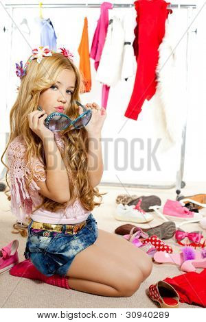 fashion victim kid girl wardrobe messy playing with sunglasses