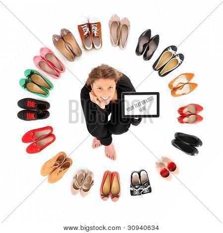 ein Bild von eine hübsche junge Frau sitzend im Kreis der Schuhe over white background