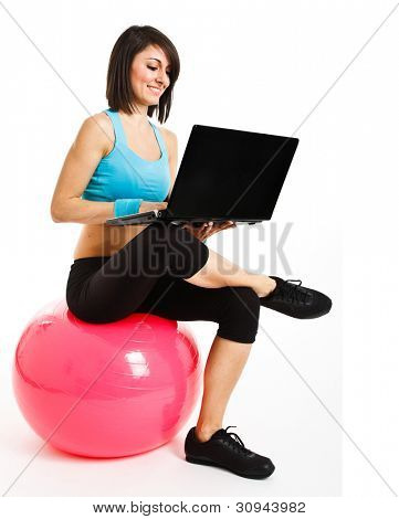 Woman working at her laptop at gym