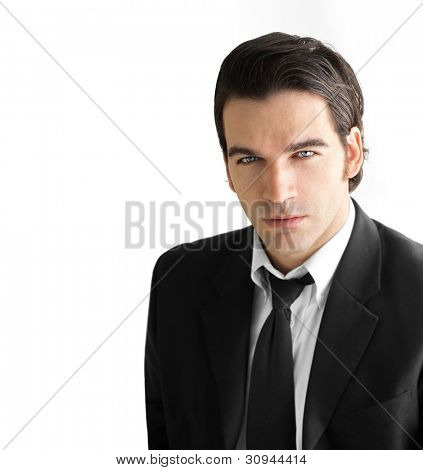 Portrait of a young handsome business man against white background