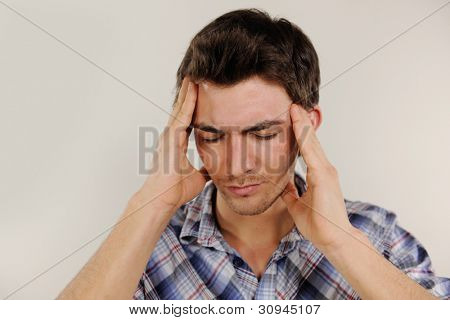 Mid adult man suffering from headache