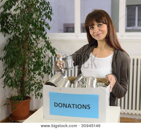 happy volunteer woman with food donation box